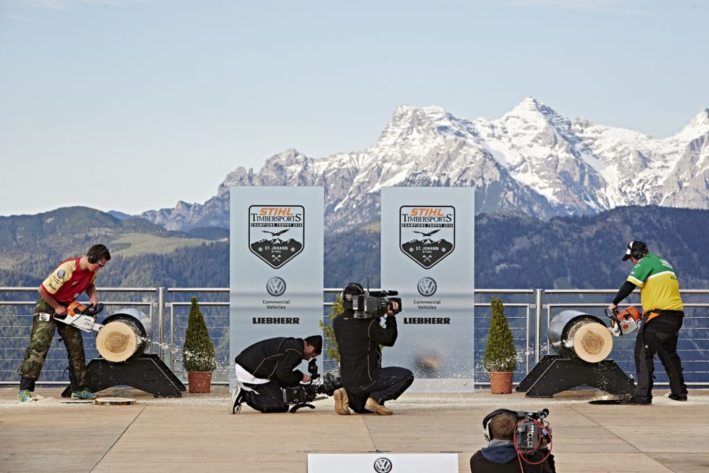 Iker Vicente of Spain and Andrew Kelly of Australia perform at the Stihl Timbersports Rookie World Championship in St. Johann in Tirol, Austria on May 25, 2016.
